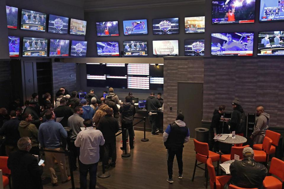 A crowd of people placed bets at the sports book bar Twin River Casino in Lincoln, R.I. on January 29, 2019. Rhode Island began accepting last year.